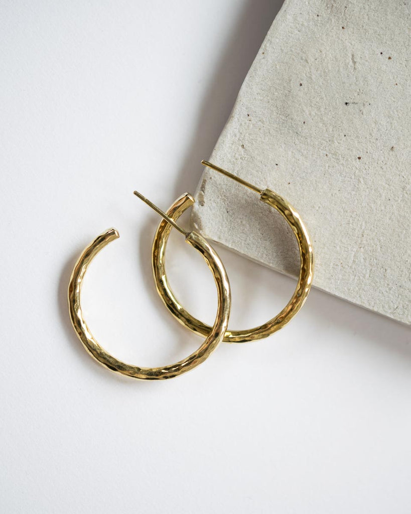 hammered hoop earrings in brass