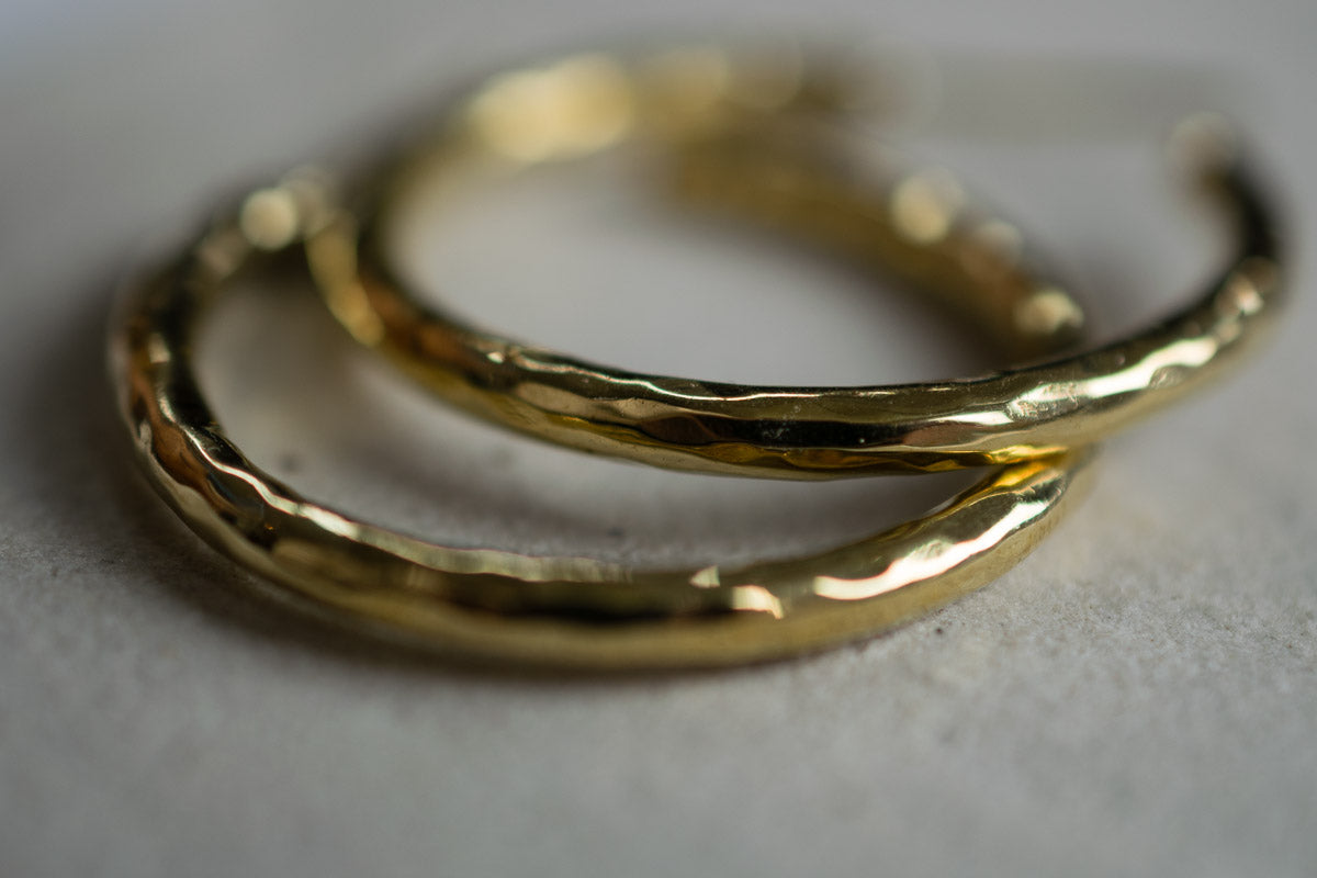 hammered brass hoop circle earrings up close