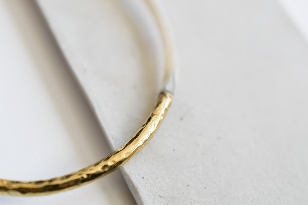 hammered brass and inset bone and horn bangle bracelet