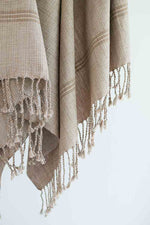 fair trade bath or beach towel woven in tan with fringe