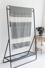 striped black and off white towel