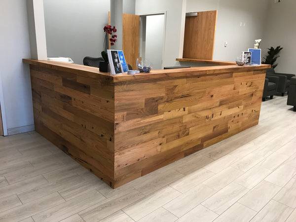 Healthcare reception desk with custom reclaimed millwork in Boston