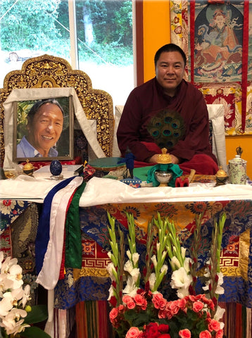 Chakung Jigme Wangdrak Rinpoche next to Lama Tharchin Rinpoche's throne, Pema Osel Ling. Photo by Sonam Basiga Famarin