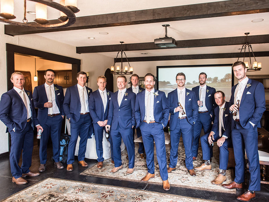 Groomsmen in bright blue wedding suits for men