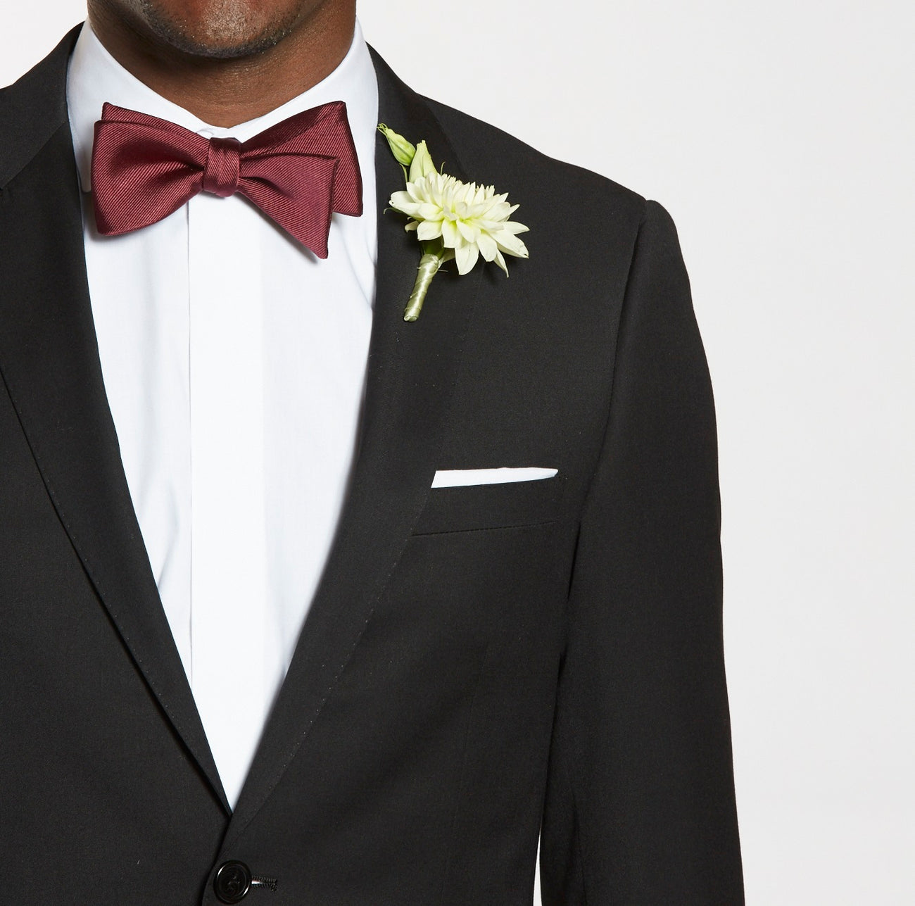 3ed7d8ad9bf9 How to Pin a Boutonniere in 3 Easy Steps | The Groomsman Suit