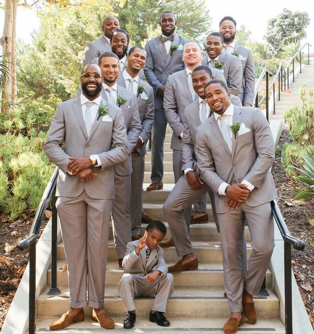 Kam Chancellor suits up his squad with The Groomsman Suit