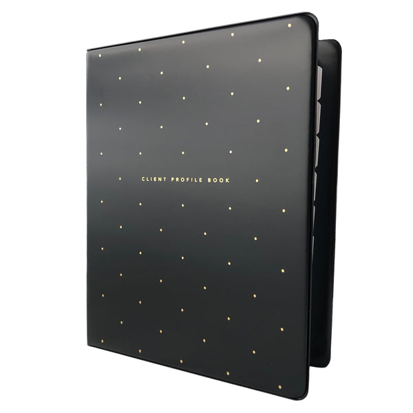 Angled view of black salon client profile book with gold polkadots. Alpha divider tabs peeking out.