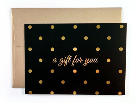 Gold polka dot gift certificate with gold envelope
