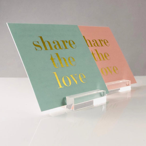 cards sitting in acrylic card display stands
