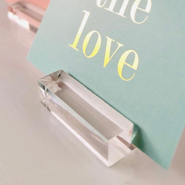 close up of card inserted in acrylic card display stand