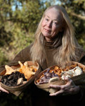 Connie Green holding baskets of wild mushrooms in The Press Democrat, December 1 2015 feature, Oregon Chanterelles Flood Sonoma County Markets by Diane Peterson - photo courtesy The Press Democrat