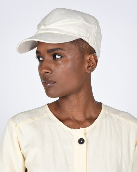 The new order cap in cream