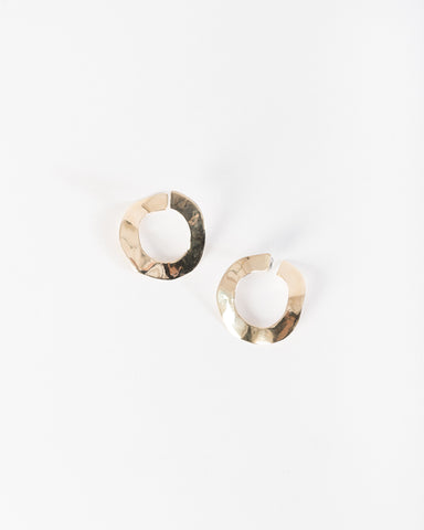 Irregular disk earrings in brass