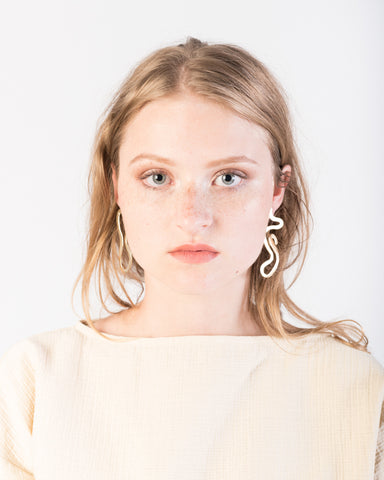 As one Earrings in brass