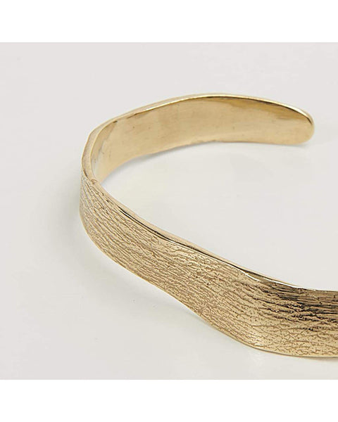 Molded wrist gold cuff with skin imprint