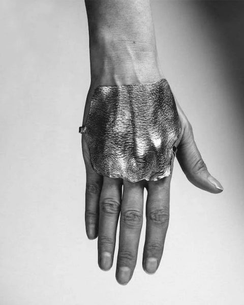 Imprinted molded hand in silver