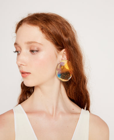 Reflection earrings in prism