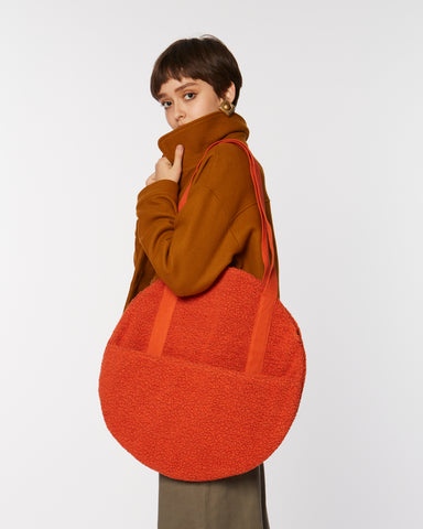 Round fleece handbag in orange