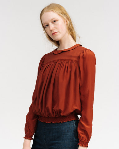 Rust silk blouse