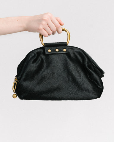 Puppy handbag in black haircalf