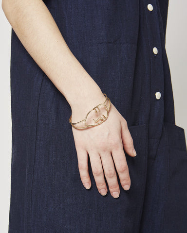 Face Bracelet in Brass