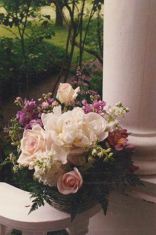 Herbaceous peony, roses, larkspur form the basis of this fragrant basket.