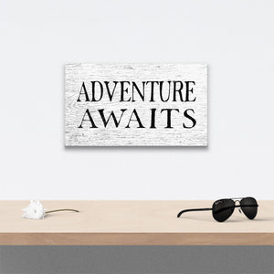 Adventure Awaits Canvas Art over table with flower and sunglasses