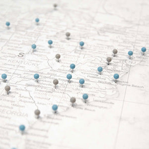 Close up of Classic Marble USA map pin board with push pins