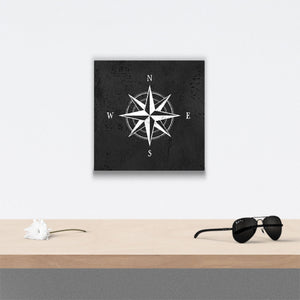 Compass Rose Canvas Art over table with flower and sunglasses