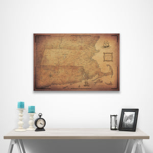 Golden Aged Massachusetts state map pin board with pushpins over a table