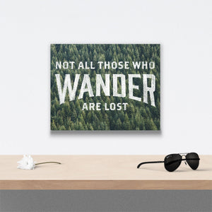 Not all those who wander are lost Canvas Art over table with flower and sunglasses