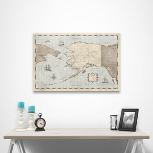 Rustic Vintage Alaska state map pin board with pushpins over a table