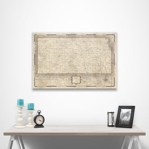 Rustic Vintage Kansas state map pin board with pushpins over a table