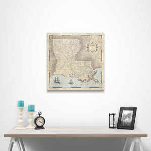 Rustic Vintage Louisiana state map pin board with pushpins over a table