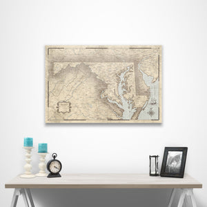 Rustic Vintage Maryland state map pin board with pushpins over a table