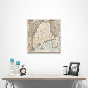 Rustic Vintage Maine state map pin board with pushpins over a table