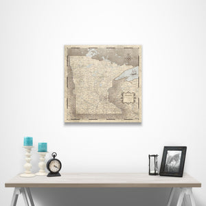Rustic Vintage Minnesota state map pin board with pushpins over a table