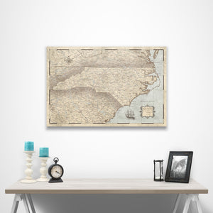 Rustic Vintage North Carolina state map pin board with pushpins over a table