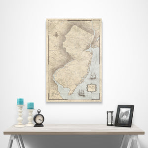 Rustic Vintage New Jersey state map pin board with pushpins over a table