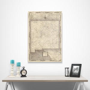 Rustic Vintage New Mexico state map pin board with pushpins over a table