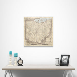 Rustic Vintage Ohio state map pin board with pushpins over a table