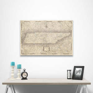 Rustic Vintage Tennessee state map pin board with pushpins over a table