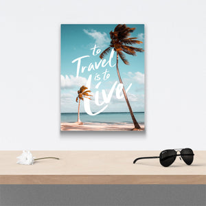 To travel is to live Canvas Art over table with flower and sunglasses