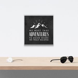 We must take adventures Canvas Art over table with flower and sunglasses