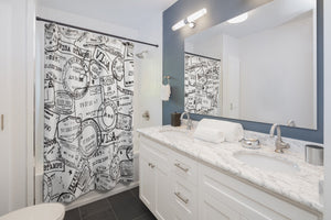 Passport stamp shower curtain in bathroom