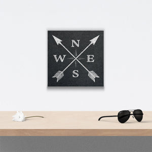 Compass X Design Canvas Art over table with flower and sunglasses