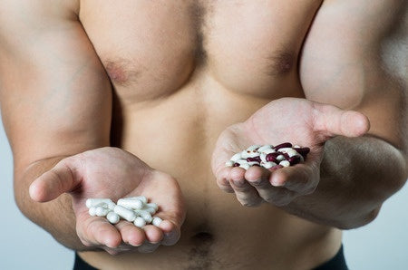 Man holding supplements