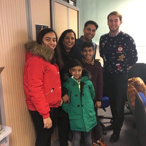 The Parmar family, with Aidan standing below his father Nilesh, joined by Briers' Designer Lewis Simper