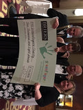 Jackie hands over giant cheque to Greenfingers Charity