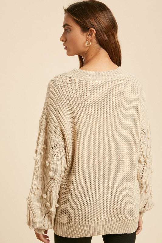 Sleighing It Knitted Sweater with Pom Accent Sleeves